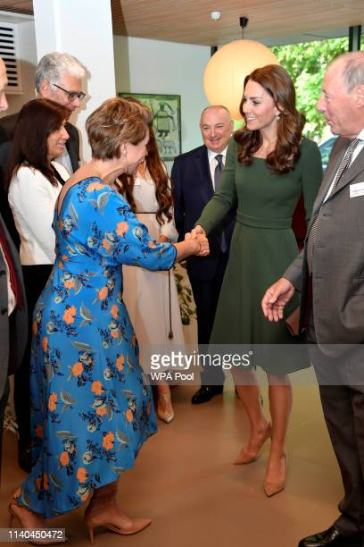 Britain's Catherine Duchess of Cambridge shakes hands with journalist Kate Silverton as she officially opens the new Centre of Excellence at the Anna...