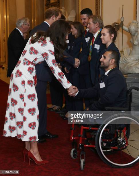 Britain's Catherine Duchess of Cambridge shakes hands with paralympic athlete Ali Jawad as she meet athletes during a reception for Team GB's Olympic...