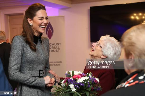 Britain's Catherine, Duchess of Cambridge shares a joke with Holocaust survivor Yvonne Bernstein after the UK Holocaust Memorial Day Commemorative...