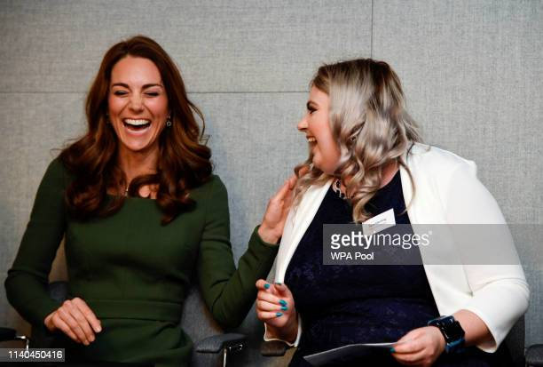 Britain's Catherine Duchess of Cambridge shares a laugh with Amy Herring an advocate and former user of the Anna Freud National Centre for Children...