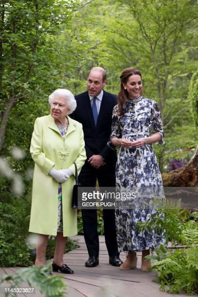 Britain's Catherine, Duchess of Cambridge shows Britain's Queen Elizabeth II and Britain's Prince William, Duke of Cambridge, around the 'Back to...
