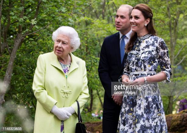 Britain's Catherine, Duchess of Cambridge shows Britain's Queen Elizabeth II and Britain's Prince William, Duke of Cambridge, around the 'Back to...