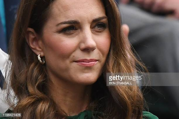 Britain's Catherine, Duchess of Cambridge sits in the Royal Box on Centre Court to watch Romania's Simona Halep playing US player Serena Williams...