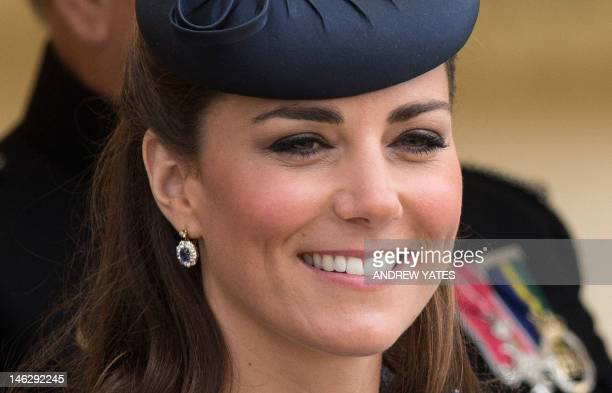Britain's Catherine Duchess of Cambridge sits watching Prince William start a children's race during a sports demonstration on their visit to Vernon...