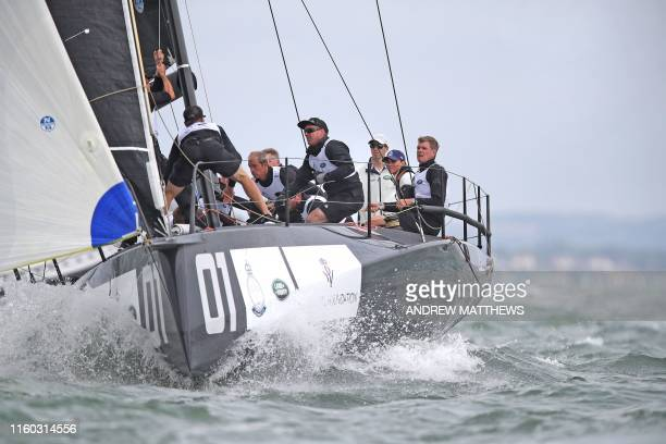 Britain's Catherine Duchess of Cambridge skippers a sailing boat in the eight boat regatta The King's Cup at Cowes off the south coast of England on...