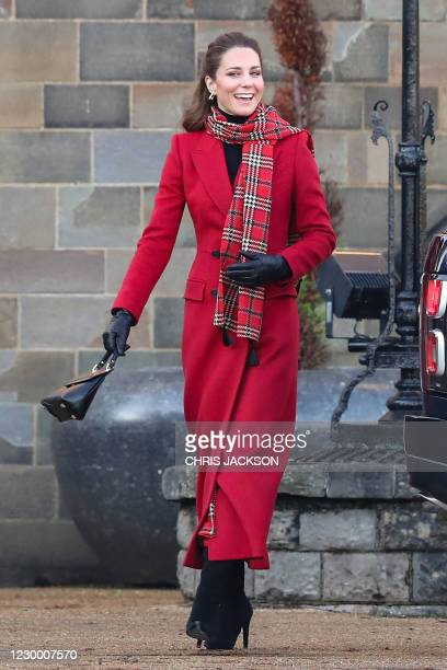 Britain's Catherine, Duchess of Cambridge smiles as she arrives at Cardiff Castle in Cardiff in south Wales on December 8 on her final day of...