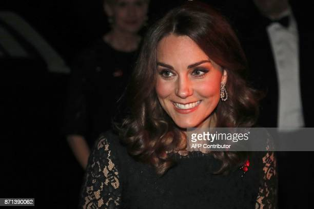 Britain's Catherine Duchess of Cambridge smiles as she arrives to attend the 2017 Gala Dinner for The Anna Freud National Centre for Children and...