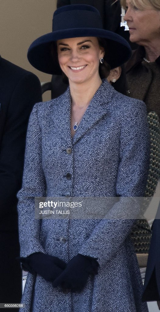 Britain's Catherine, Duchess of Cambridge smiles as she attends a Service of Commemoration and Drumhead Service on Horse Guards Parade in central London on March 9, 2017, which honours the service and duty of both the UK Armed Forces and civilians in the Gulf region, Iraq and Afghanistan, and those who supported them back home, from 1990-2015. After the Drumhead Service, The Queen will officially unveil The Iraq and Afghanistan memorial. / AFP PHOTO / Justin TALLIS