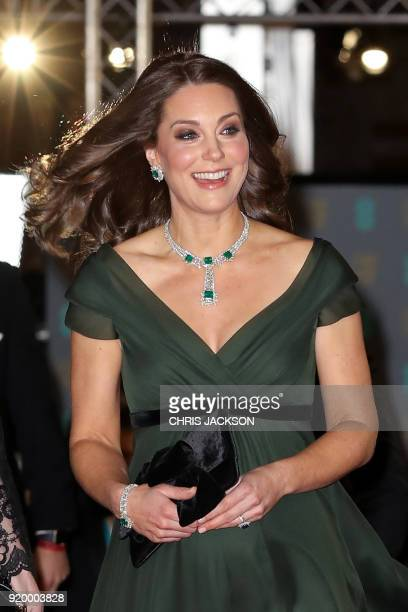 Britain's Catherine Duchess of Cambridge smiles as she attends the BAFTA British Academy Film Awards at the Royal Albert Hall in London on February...