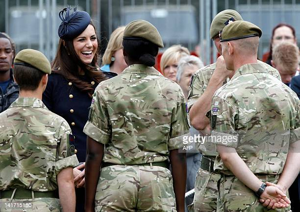 Britain's Catherine Duchess of Cambridge smiles as she greets members of the 1st Battalion Irish Guards after she presented operational medals for...