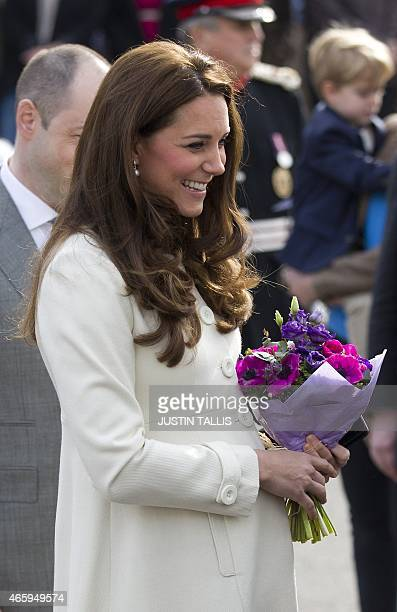 Britain's Catherine Duchess of Cambridge smiles as she meets members of the cast on the set of British television series Downton Abbey at Ealing...