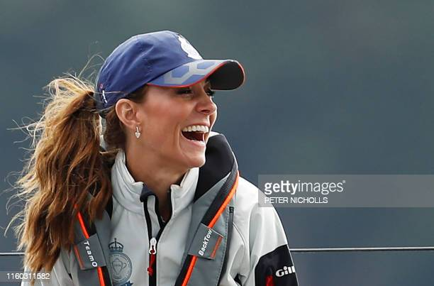 Britain's Catherine Duchess of Cambridge smiles as she skippers a sailing boat in the eight boat regatta The King's Cup at Cowes off the south coast...