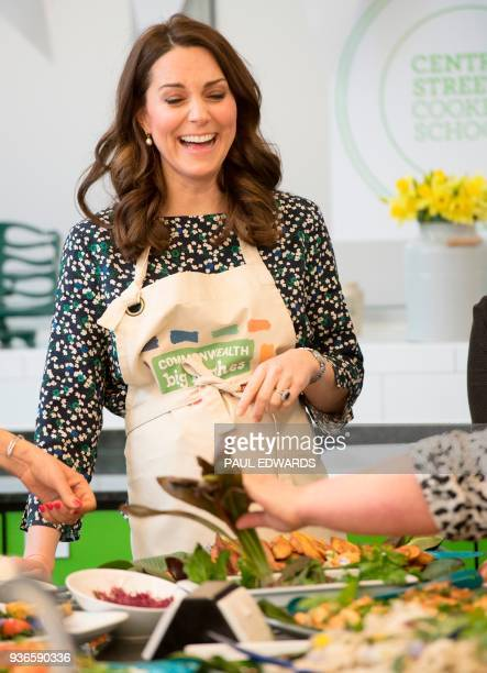 Britain's Catherine, Duchess of Cambridge smiles as she takes part in preparations for a Commonwealth Big Lunch at St Luke's Community Centre, in...
