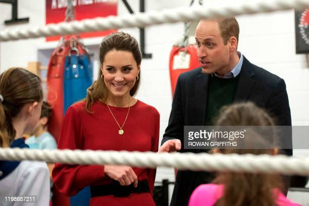 Britain's Catherine Duchess of Cambridge smiles during a visit with her husband Britain's Prince William Duke of Cambridge to the Bulldogs...