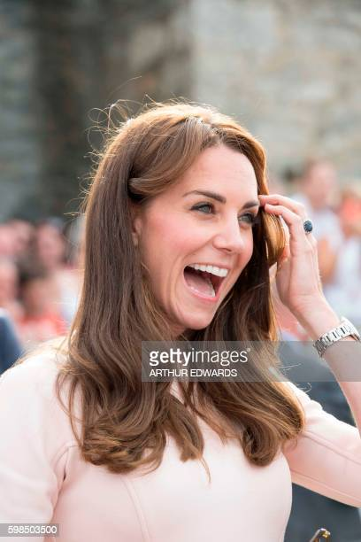 Britain's Catherine Duchess of Cambridge smiles on a visit to the Wave Project on Newquay's Towan Beach in south west England on September 1 2016 The...