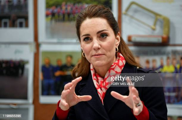 Britain's Catherine Duchess of Cambridge speaks to employees at the training centre during her visit to the Tata Steel plant in Port Talbot south...