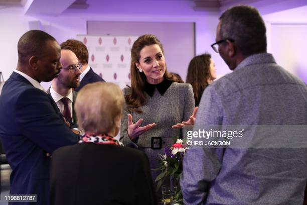 Britain's Catherine Duchess of Cambridge speaks to holocaust and genocide survivors after the UK Holocaust Memorial Day Commemorative Ceremony at...