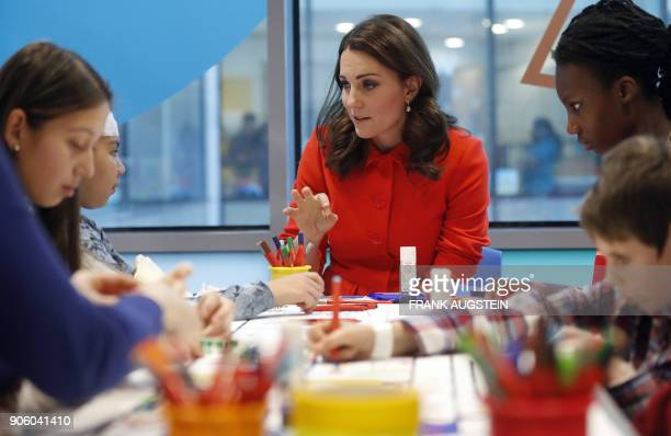 Britain's Catherine Duchess of Cambridge speaks to patients during her visit to officially open the Mittal Children's Medical Centre home to the new...