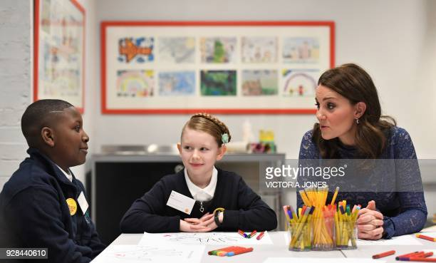 Britain's Catherine, Duchess of Cambridge speaks to pupils from Albion Primary School during a visit to officially open the new headquarters of...