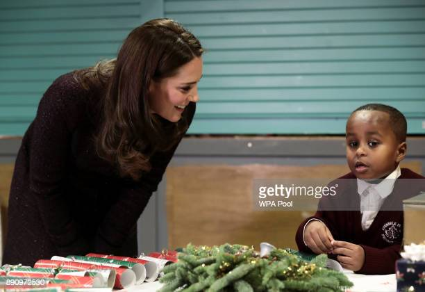 Britain's Catherine Duchess of Cambridge speaks to Yahya Hussein Ali 7 who was affected by the Grenfell Tower fire during a visit to the Rugby...