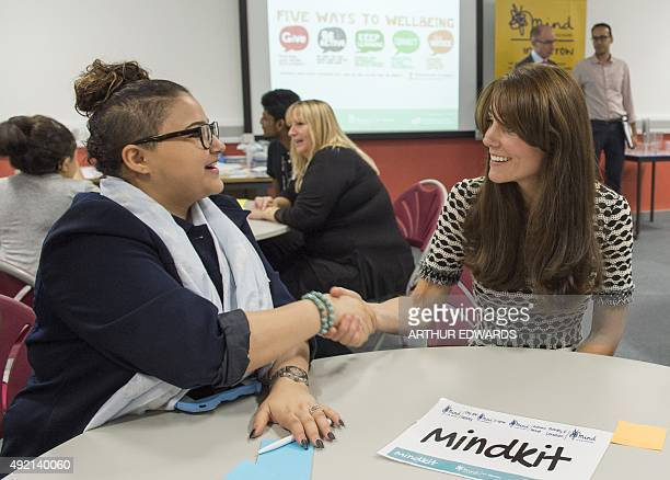 Britain's Catherine Duchess of Cambridge speaks to youngsters at an event in London to mark World Mental Health Day on October 10 2015 The Duke and...