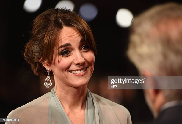 Britain's Catherine Duchess of Cambridge speaks with British director Sam Mendes at the world premiere of the new James Bond film 'Spectre' at the...