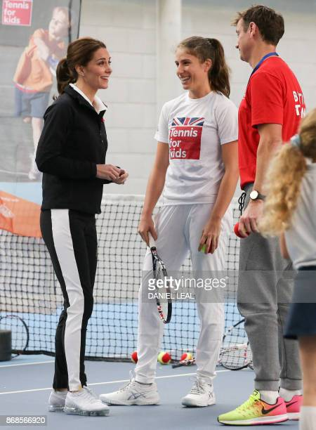 Britain's Catherine Duchess of Cambridge speaks with British player Johanna Konta as she prepares to take part in a Tennis for Kids session during a...