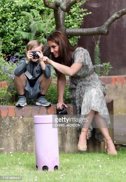 Britain's Catherine, Duchess of Cambridge speaks with Josh Evans as she takes part in a a photography workshop with the charity 'Action for Children'...