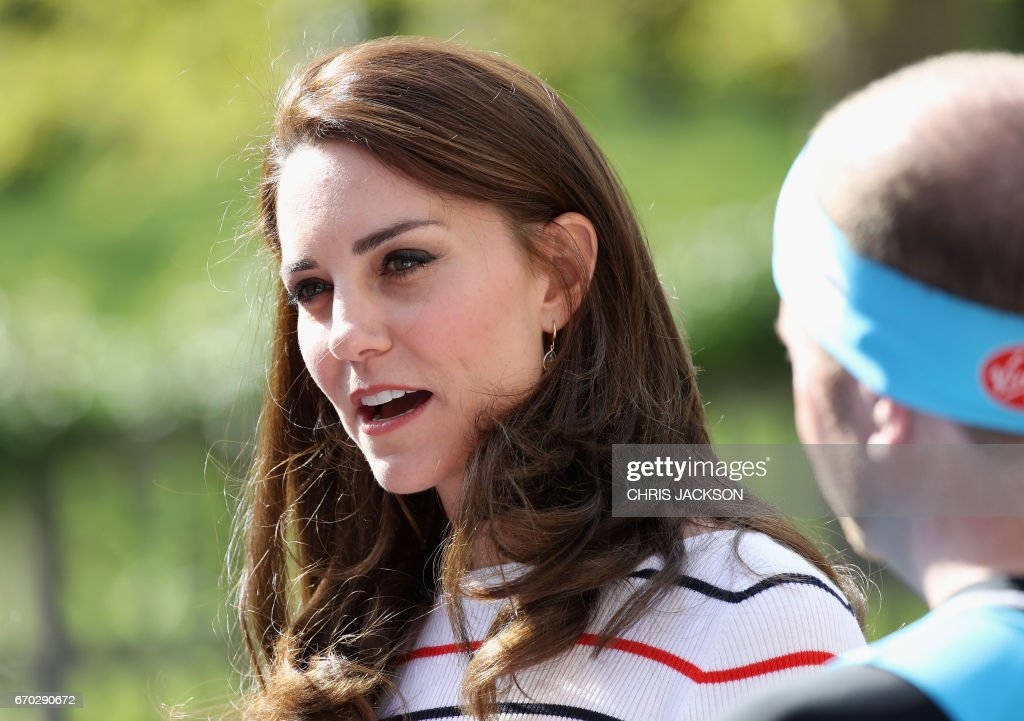 Britain's Catherine, Duchess of Cambridge speaks with runners from Team Heads Together ahead of the 2017 Virgin Money London Marathon, at Kensington Palace on April 19, 2017 in London. Mental health campaign, Heads Together is the Charity of the Year for the Virgin Money London Marathon which will be run on April 23, 2017. / AFP PHOTO / POOL / Chris Jackson