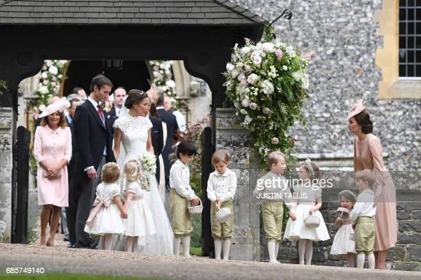 Britain's Catherine, Duchess of Cambridge stands with her children Britain's prince George and Britain's princess Charlotte, following the wedding of...