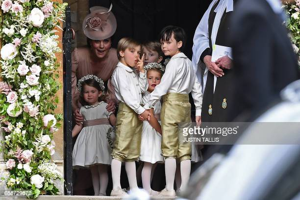 Britain's Catherine, Duchess of Cambridge stands with her daughter Britain's princess Charlotte, and the other bridesmaids and pageboys, as they...