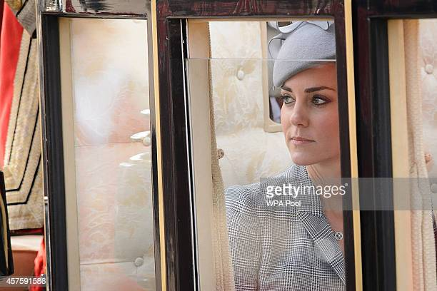 Britain's Catherine Duchess of Cambridge takes her seat a State Carriage for the carriage procession to Buckingham Palace as part of the ceremonial...