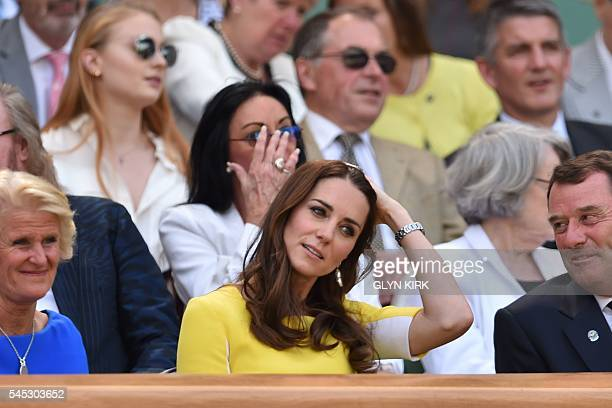 Britain's Catherine, Duchess of Cambridge takes her seat in the royal box on centre court to watch the women's semi-final match between US player...