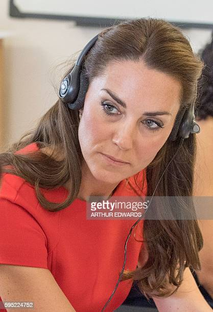 Britain's Catherine Duchess of Cambridge takes part in a taster session with some of the training volunteers at a mental health charity helpline...