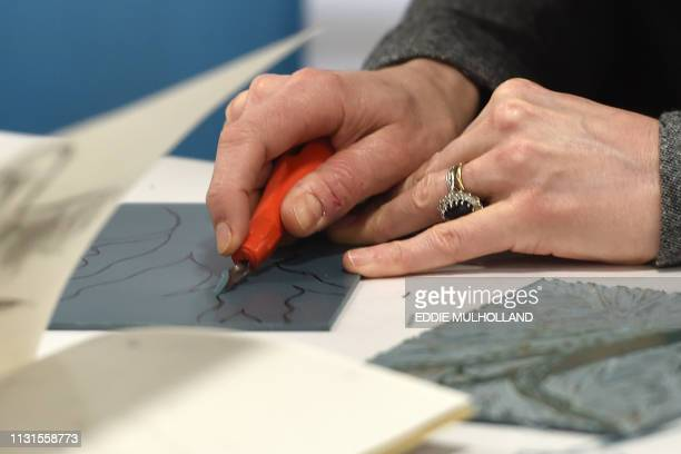 Britain's Catherine Duchess of Cambridge takes part in an activity during her visit to the Foundling Museum where young people are taught to use art...