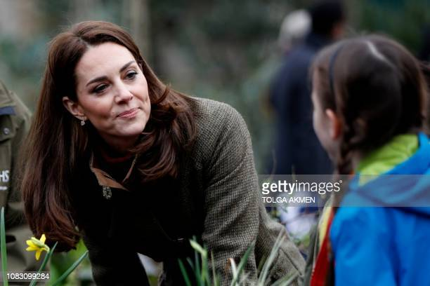 Britain's Catherine Duchess of Cambridge talks to children as she visits the Islington community garden in north London on January 15 2019