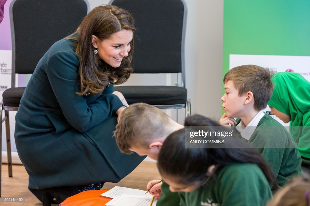 Britain's Catherine, Duchess of Cambridge (L) talks to children during a visit The Fire Station, an iconic building recently converted into a music and arts hub, in Sunderland, northeast England, on February 21, 2018. The Duke and Duchess of Cambridge visited Sunderland to learn about the city's arts scene and engineering talent. / AFP PHOTO / POOL / Andy COMMINS