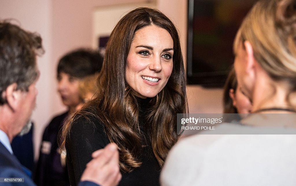 Britain's Catherine, Duchess of Cambridge talks to staff members of the Nelson trust women centre in Gloucester, western England on November 4, 2016. The Women's Centre was set up in 2010 and is designed to support women who have vulnerabilities, particularly those who have experienced abuse and trauma. / AFP / POOL / RICHARD