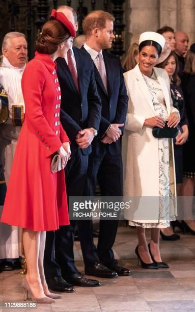 Britain's Catherine Duchess of Cambridge talks with Britain's Meghan Duchess of Sussex as Britain's Prince William Duke of Cambridge and Britain's...