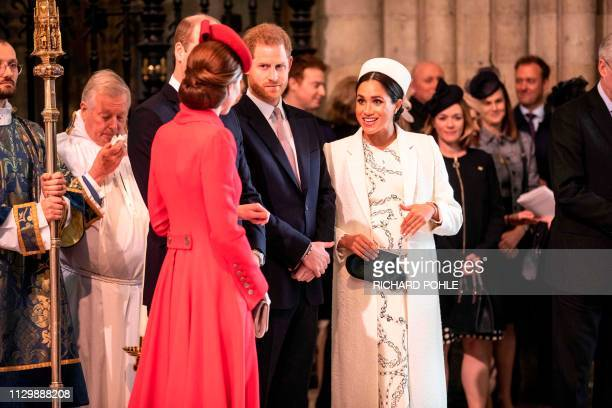 Britain's Catherine, Duchess of Cambridge , talks with Britain's Meghan, Duchess of Sussex as Britain's Prince William, Duke of Cambridge, and...