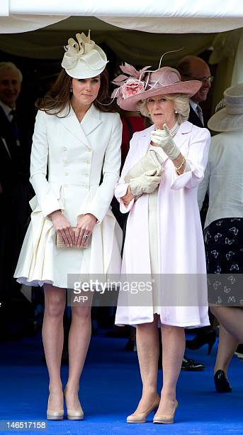 Britain's Catherine Duchess of Cambridge talks with Camilla Duchess of Cornwall as they watch the annual procession to St George's chapel for the...