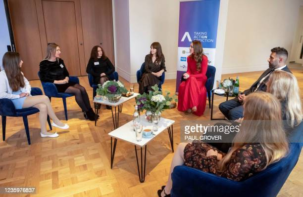 """Britain's Catherine, Duchess of Cambridge talks with families of recovered addicts during the launch of the Forward Trust charity's """"Taking Action on..."""