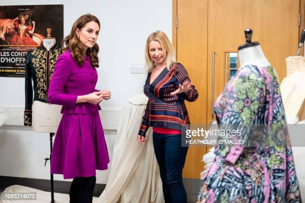 Britain's Catherine Duchess of Cambridge talks with head of ladies workroom Catriona Paterson during a visit to the costume department at the Royal...