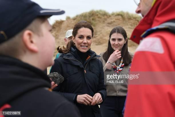 Britain's Catherine Duchess of Cambridge talks with members of Menai Bridge Scouts as she explores the wildlife habitat on Newborough Beach on...