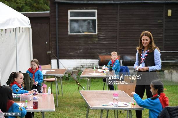 Britain's Catherine, Duchess of Cambridge talks with members of the Beavers as she visits a Scout Group in Northolt, northwest London on September 29...