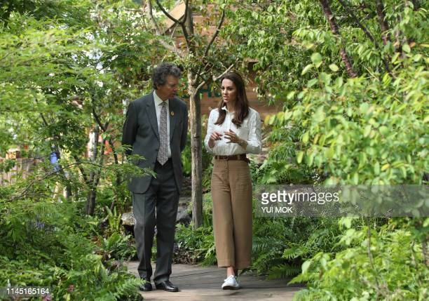 Britain's Catherine Duchess of Cambridge talks with Nicholas Bacon Royal Horticultural Society chairman during her visit to the 2019 RHS Chelsea...
