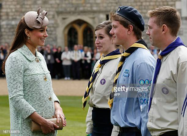 Britain's Catherine Duchess of Cambridge talks with participants during the National Review of Queen's Scouts at Windsor Castle in Berkshire on April...
