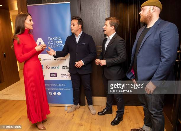 Britain's Catherine, Duchess of Cambridge talks with television presenters Ant McPartlin , Declan Donnelly and Scottish singer-songwriter Tom Walker...