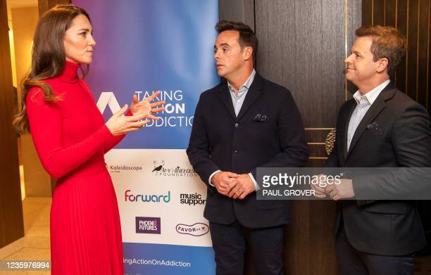 Britain's Catherine, Duchess of Cambridge talks with television presenters Ant McPartlin and Declan Donnelly during the launch of the Forward Trust...