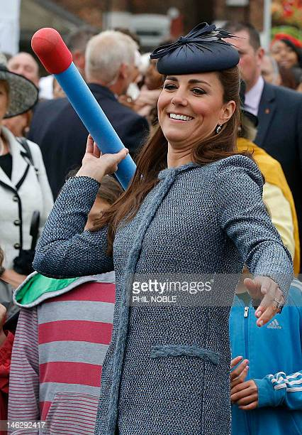 Britain's Catherine Duchess of Cambridge throws a foam javelin as she joins in with a children's sports event during a visit to Vernon Park in...